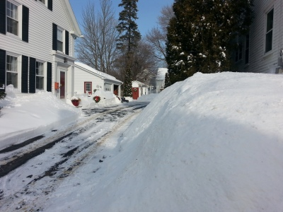 Snow buries signs and homes